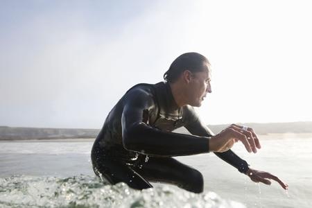Man surfing a wave.
