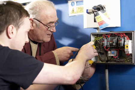 Electrical engineers working in shop