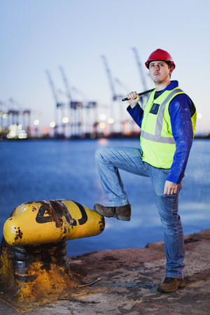 Worker standing at anchor in shipyard Stock Photo