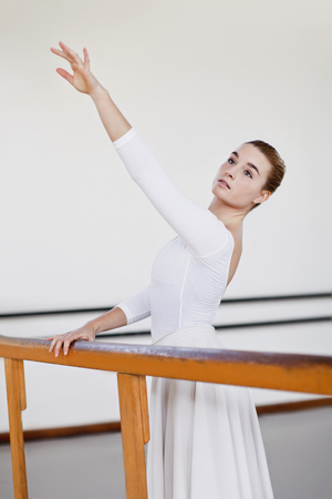 Ballet dancer posing at barre