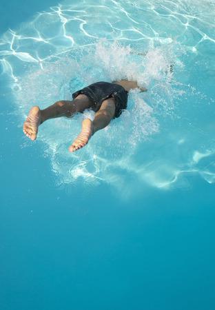 Man diving into swimming pool Stok Fotoğraf