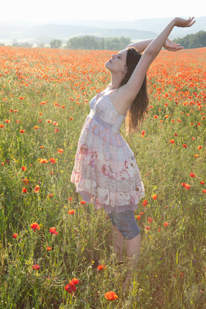 Pregnant woman in field of flowers Stock Photo
