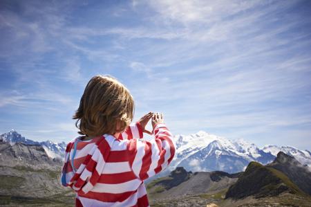 Boy admiring rocky landscape