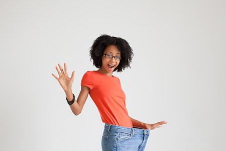 Woman with loose jeans Stock Photo