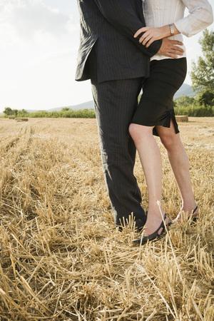 Couple in a wheat field. Фото со стока