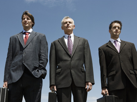 Three Businessmen standing side by side. Фото со стока