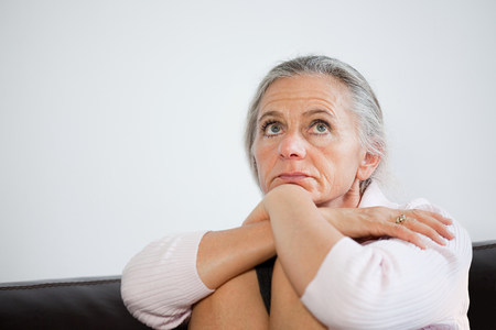 Mature woman looking anxious Stock Photo