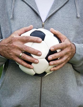 Mans hands holding football Stock fotó