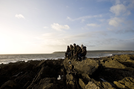 Group of Friends sitting on rock Stock Photo - 85899963