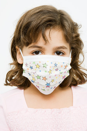 Girl in a protective mask Stock Photo