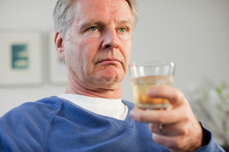 Man with glass of whisky