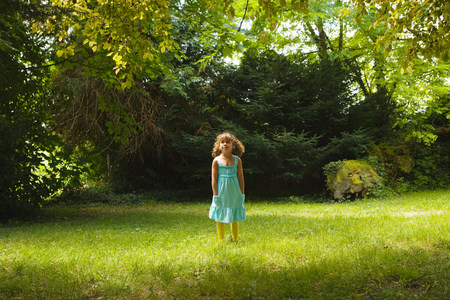 A girl standing in a forest