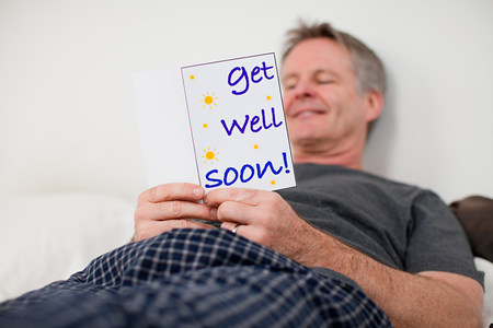 Man with get well soon card