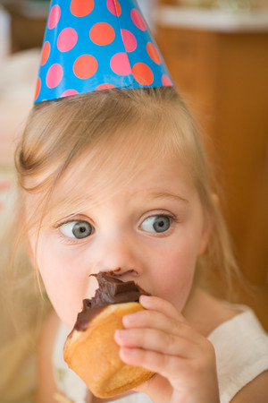 Little girl with a cupcake