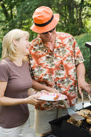 Couple having a barbecue Stock Photo