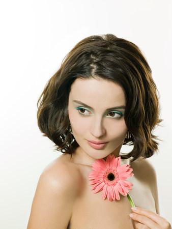 Jonge vrouw met bloem