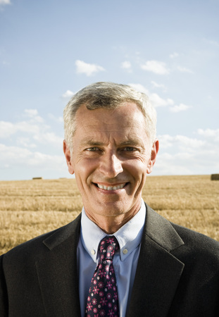 Businessman in a wheat field.