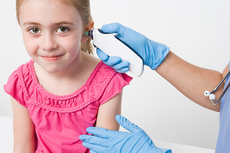 Girl with thermometer in ear