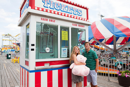 Teenage couple at ticket booth on pier