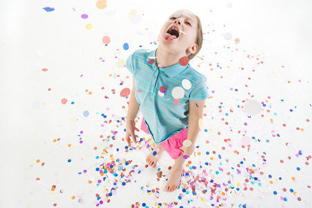 A girl playing in confetti Stock Photo