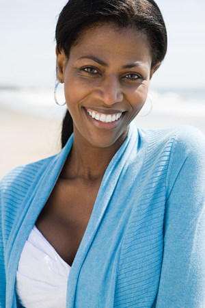 Smiling woman on a beach