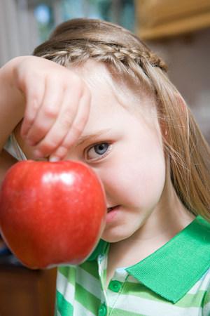 Girl holding an apple Stock Photo