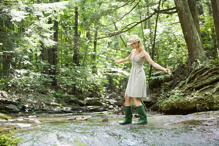Woman walking in river Standard-Bild