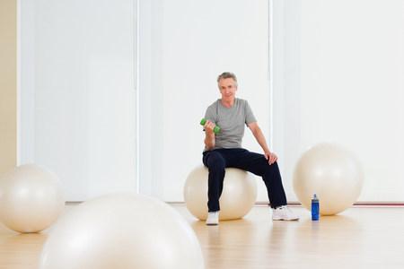 A man lifting dumbbells