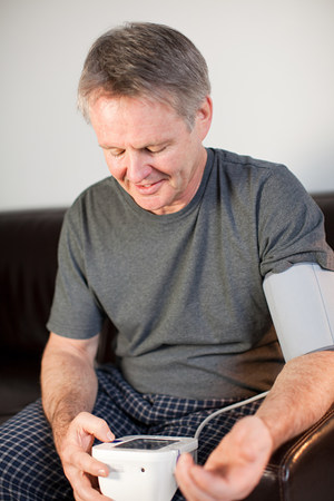 Man using blood pressure monitor