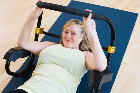Mature woman doing sit ups
