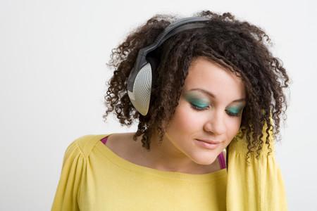 Teenage girl listening to music 版權商用圖片