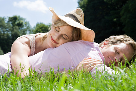 Couple lying in field