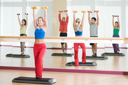 woman mirror: Fitness class Stock Photo