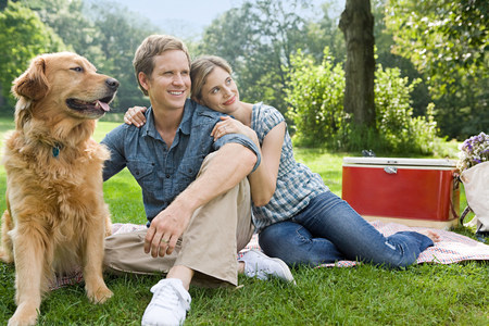 bedspread: Couple having picnic with their dog