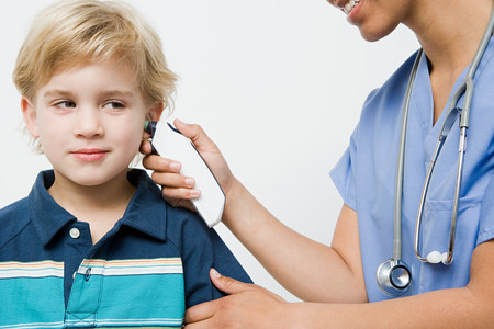 Boy with thermometer in ear
