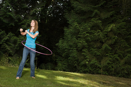 Teenage girl with plastic hoop