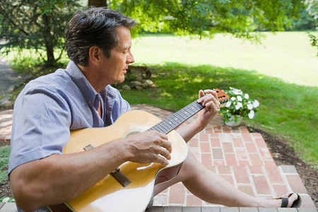 Man playing guitar outdoors