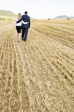 Couple in a wheat field. Фото со стока