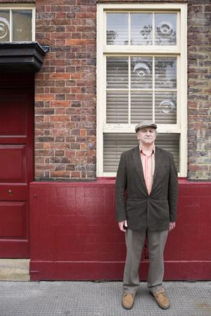 Senior man outside building Stock Photo