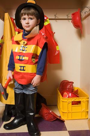 A boy pretending to be a firefighter