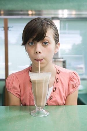 Girl drinking a milkshake