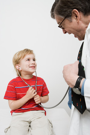 Boy and doctor with stethoscope Stock Photo - 86036413