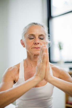 Mature woman practicing yoga