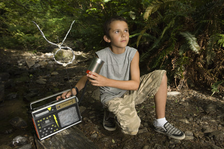 Boy outdoors with radio
