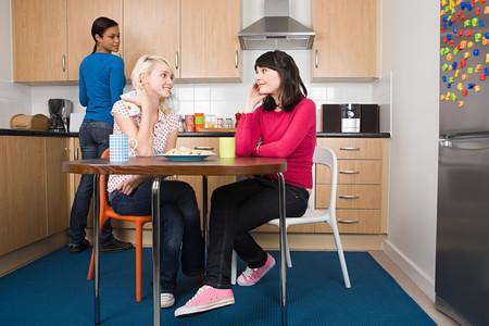 Three flatmates in a kitchen