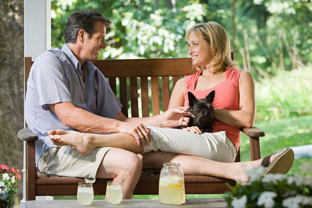 Couple on bench with dog Stock Photo
