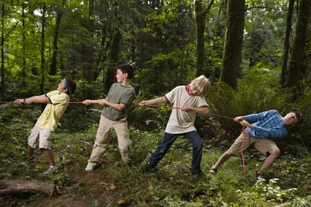 Boys pulling rope