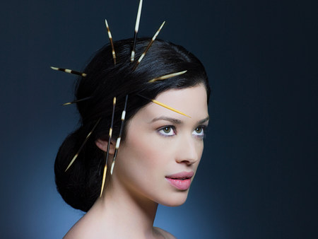Young woman with porcupine quills in hair