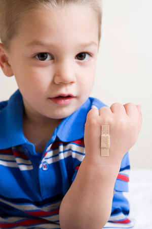 Boy with plaster on hand