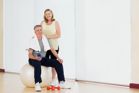 Portrait of a couple in a gym Stock Photo - 86036576